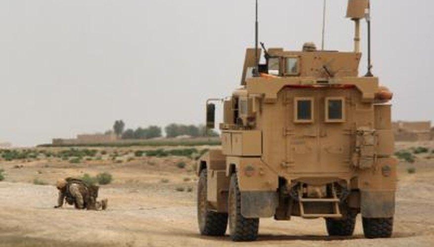 A U.S. Marine with the Explosive ordnance disposal unit defuses a Taliban IED near Baqwa, Afghanistan