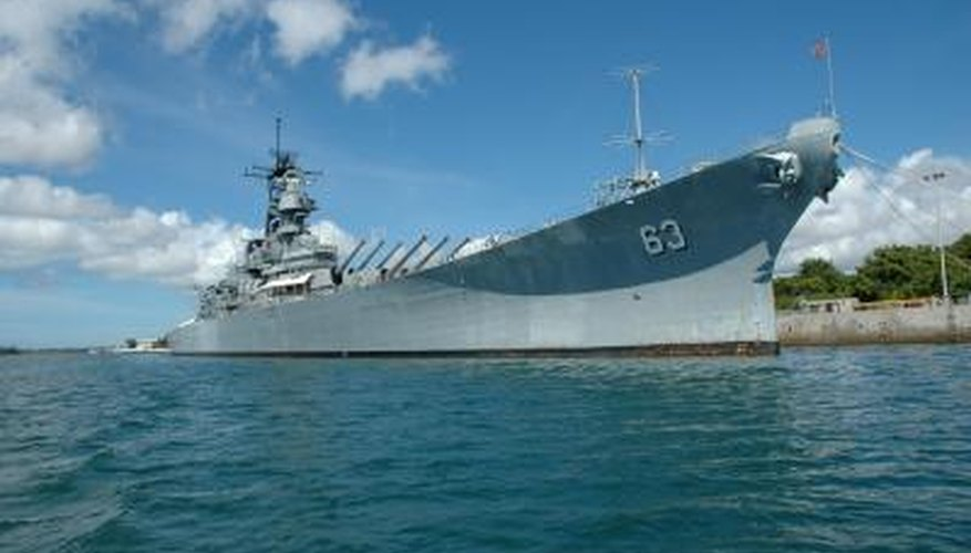 Battleships, such as the USS Missouri, carried heavy guns to attack enemy warships.