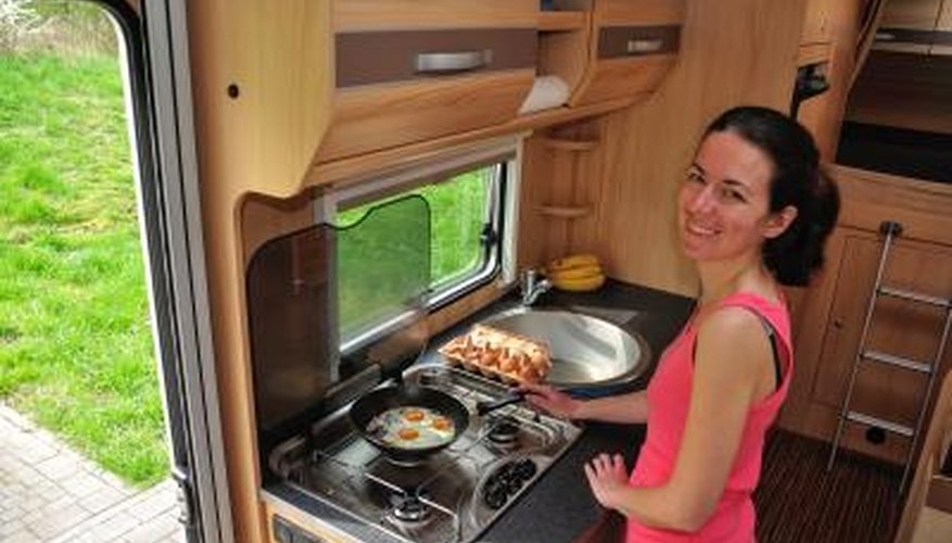 Class C motorhomes often offer an overhead sleeping area, which gives extra room for a living area with kitchen.