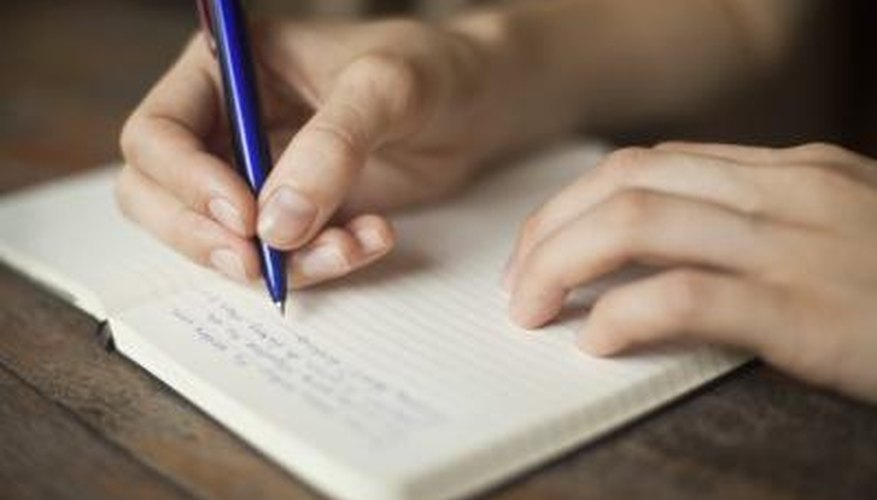 Person writing a letter.