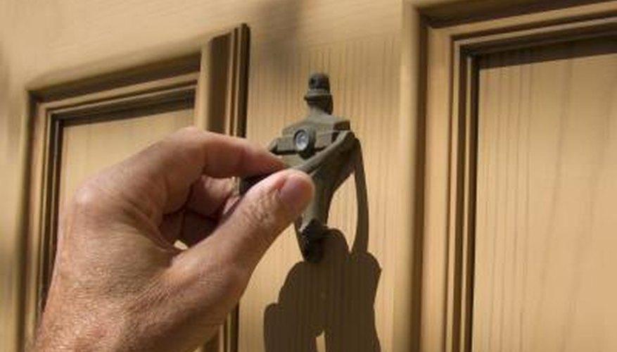 Hand on door knocker.