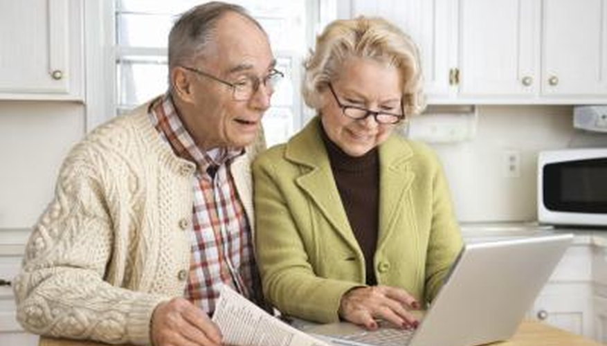 Senior couple working on a laptop.