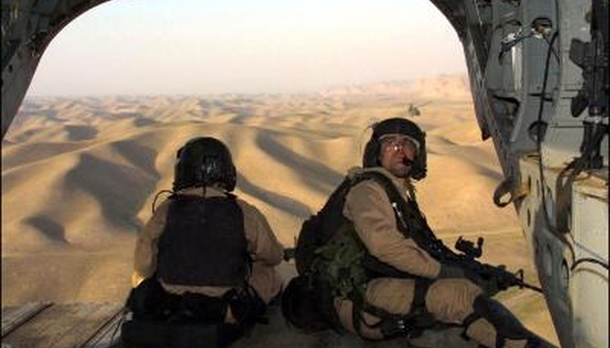 US Army Special Forces troops aboard chinook helicopter over Afghanistan