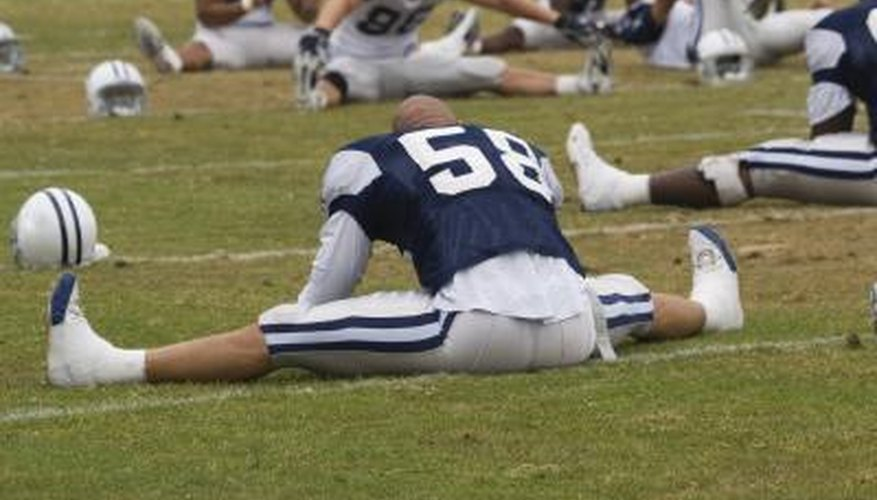 NFL football player stretching.