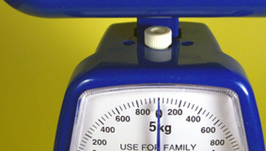 Mechanical scales weigh in grams and kilograms.