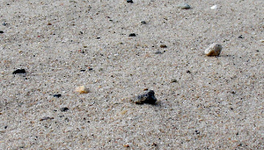 Beach sand contains impurities that don't mix well with acrylic paint.