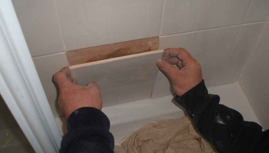 Reusing wall tiles is possible if you remove them carefully.