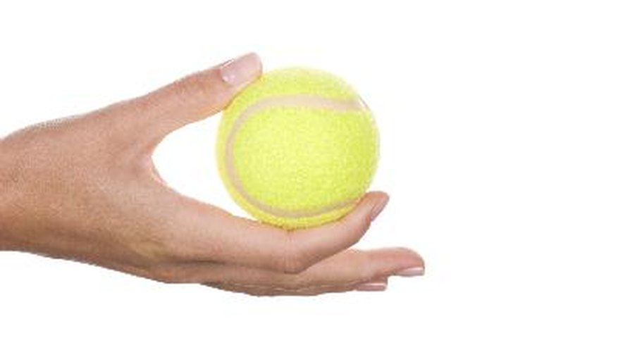 Squeezing an object like a tennis ball can help improve shaky hands.