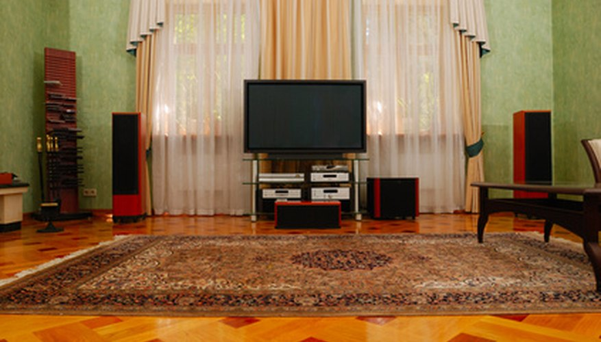 It's possible to hide the wires of a home-theatre system even without carpeting.