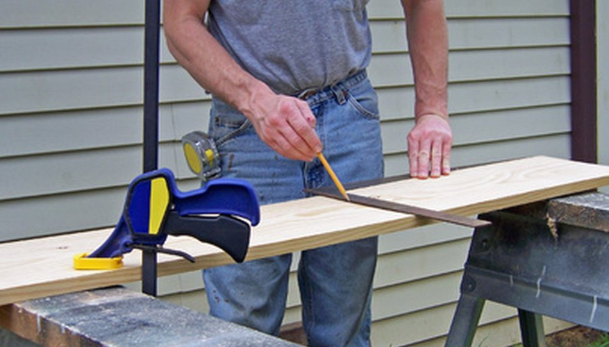 Drawing your desired curve on plywood, and cutting out the curve, helps you to bend the aluminium tubing as desired.