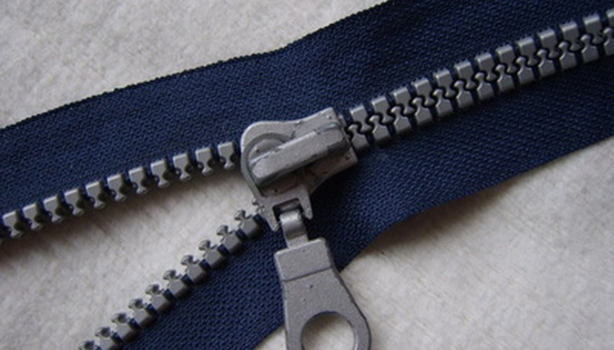 The three main parts of a zipper are cloth tape, teeth and a slider