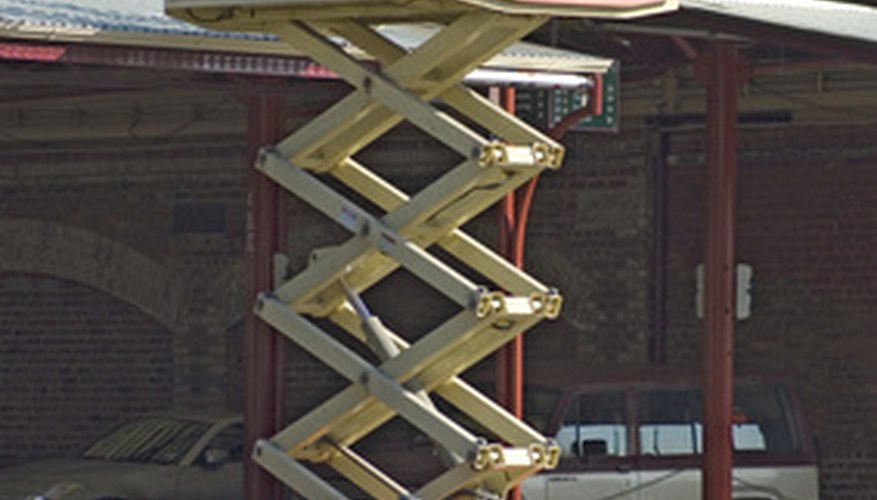 A motorised scissor lift capable of reaching several stories in height