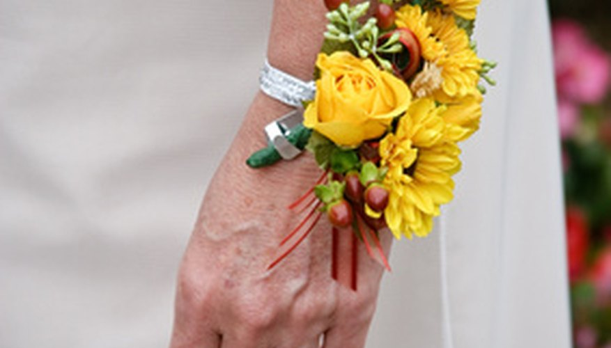 A fabric corsage attached to your purse is more durable than a flower strapped to your wrist.