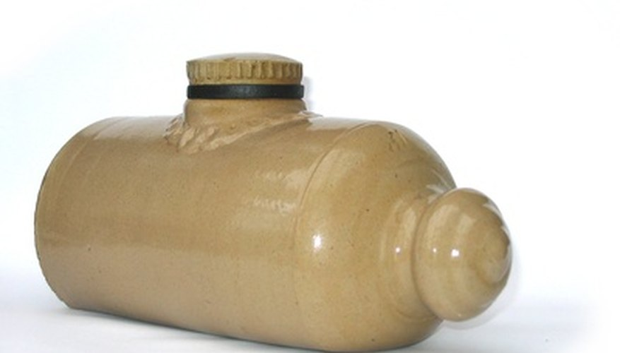Older hot water bottles were made of ceramic material, but modern bottles are typically made of rubber.