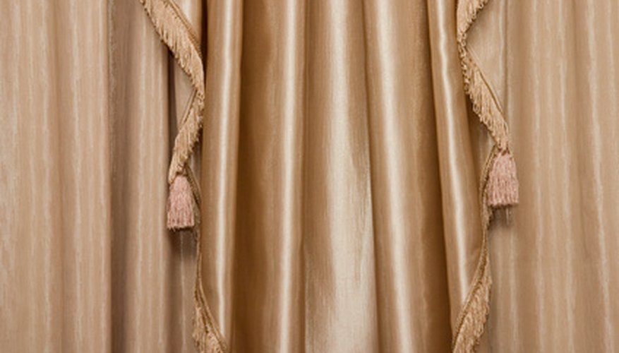Multilayered window treatments add a formal touch to the design of a room.