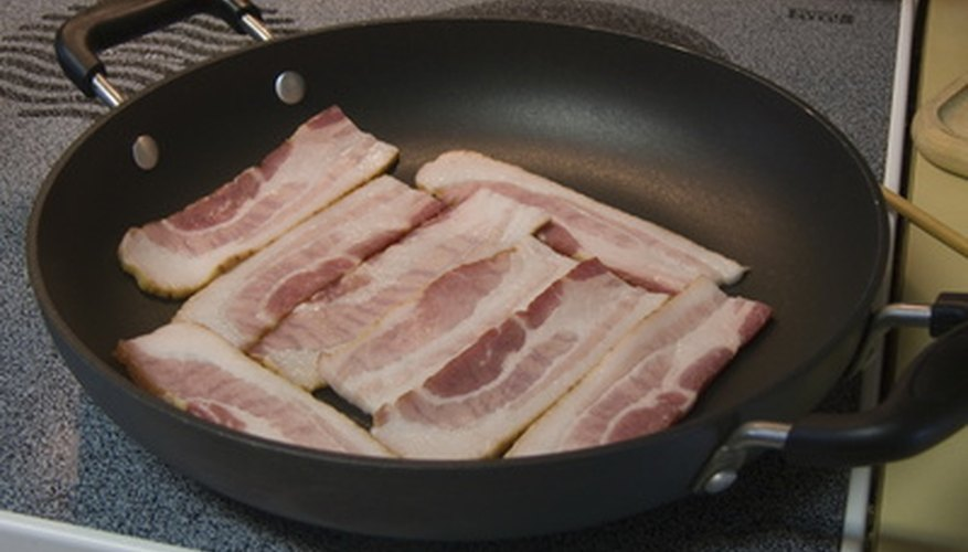 Keep your bacon flat as it fries with a bacon press.