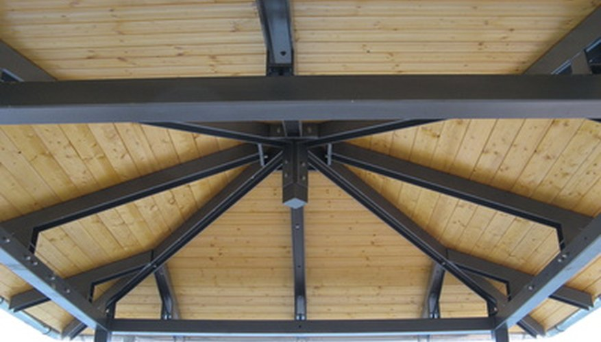 Treat wooden beams with stain and varnish to preserve their condition.