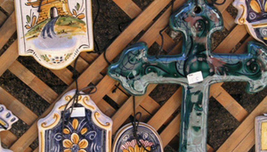 These trinkets are decorated with the coloured glass paste known as enamel.