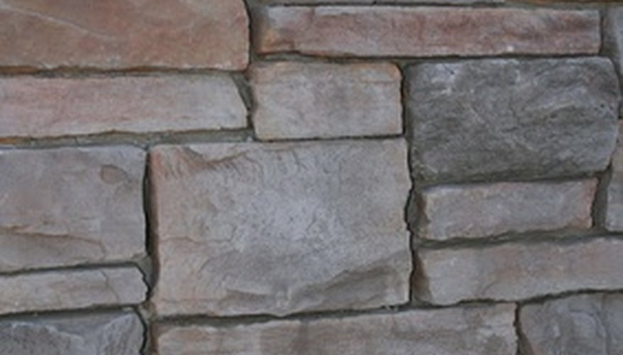 Stone is commonly used to build a retaining wall.