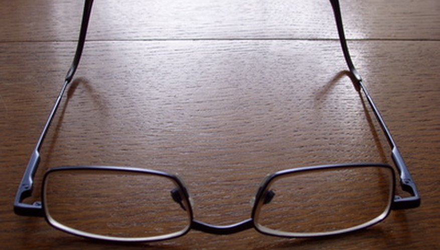 Use the appropriate solvent to clean paint from glasses.