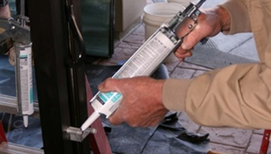 Caulk tubes are placed in a gun for easy use.