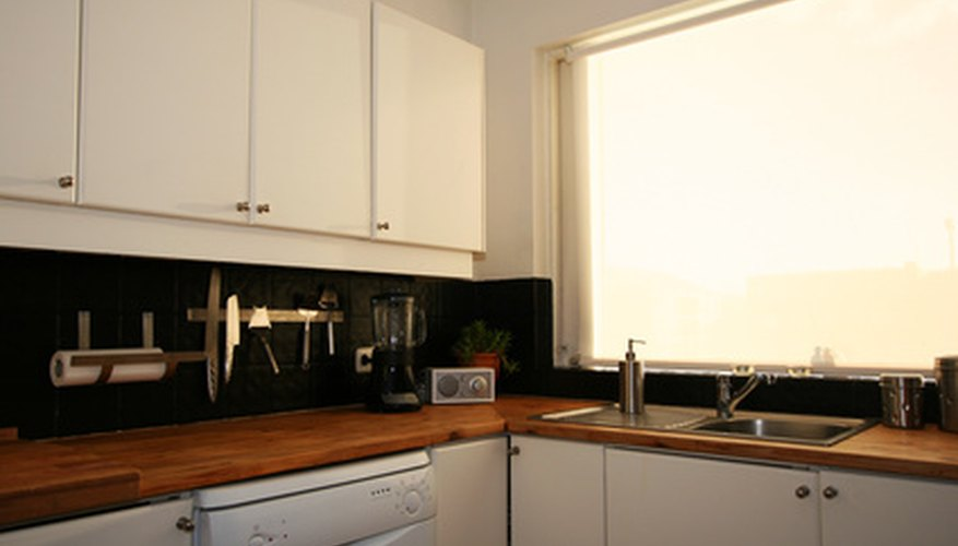 Particle board kitchen cabinets can swell.