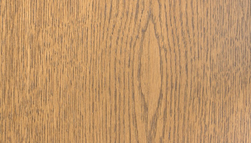 Always wipe in the direction of the wood grain.