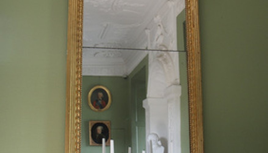 Age this old mirror with an application of muriatic acid.