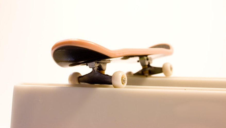 Adjust the wheels and trucks on a Tech Deck, even if you've lost the yellow tool.