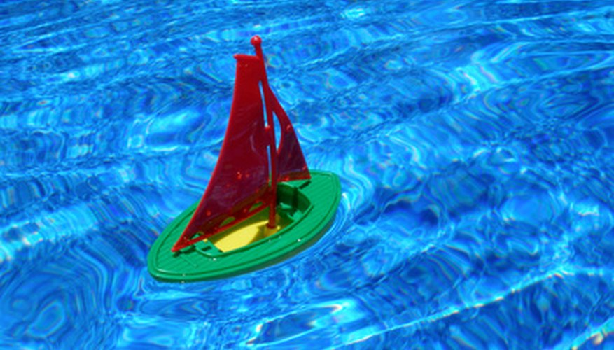 Children can create sailboats from objects around the house.