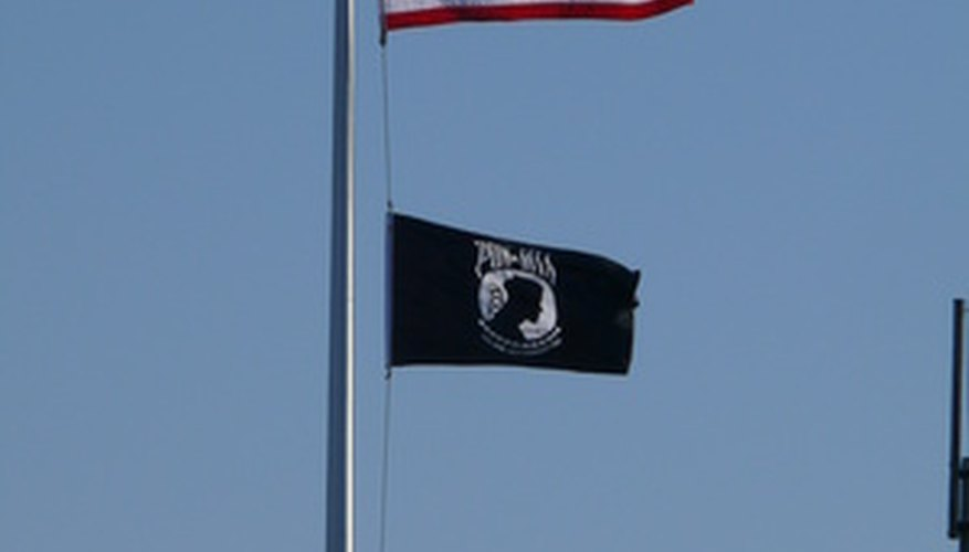 Flag poles use a single fixed pulley for raising and lowering flags.
