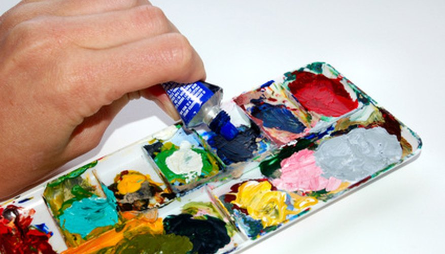 Teaching acrylic painting involves explanation and demonstration.
