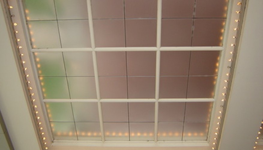 This tray ceiling has mirrors in the recessed area and rope lighting.