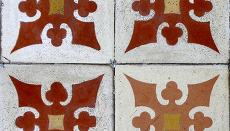Paint designs on unglazed tiles to match your home's decor.