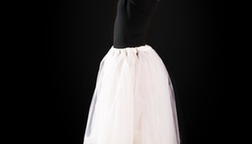 A coloured layer of tulle between two layers of white tulle adds an iridescent glow.