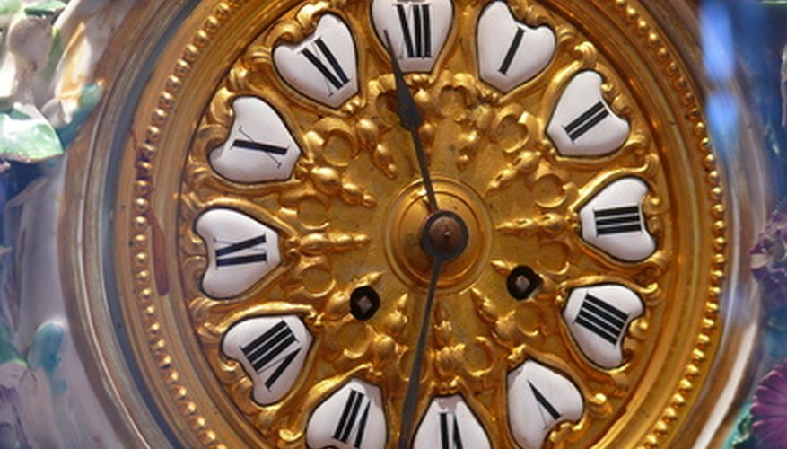 Clock hands and the hand nut.