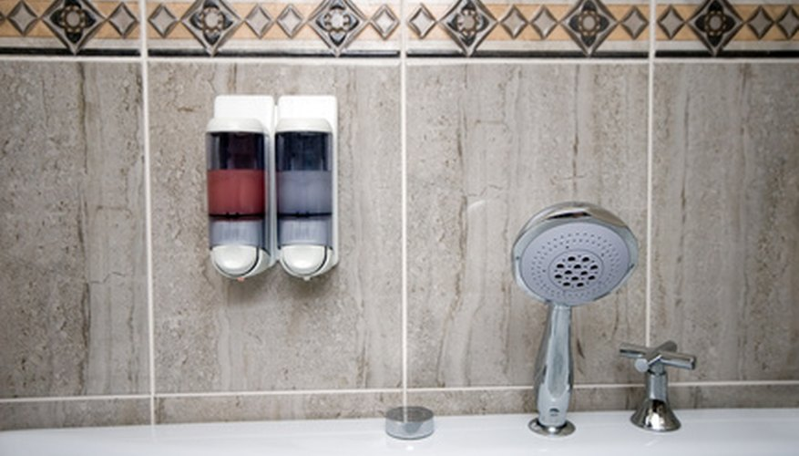 Soap dispensers in public bathrooms often require a manual push to eject a preset amount of liquid soap.