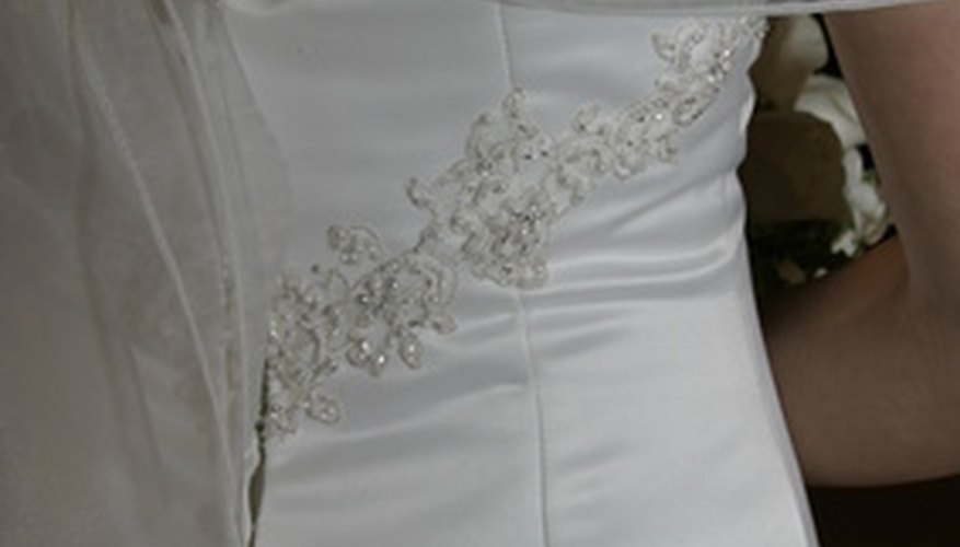 Matching the fabric allows panels to blend into the original gown.