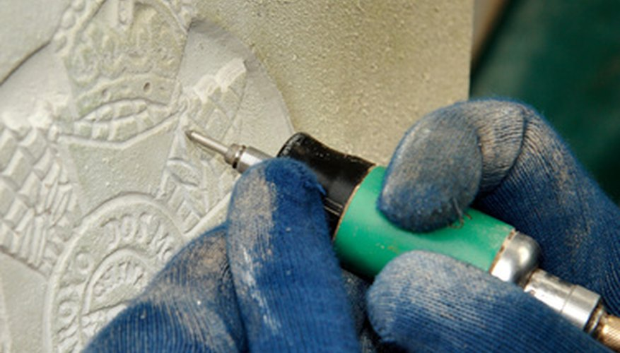 Engraving slate creates art from pieces of stone.