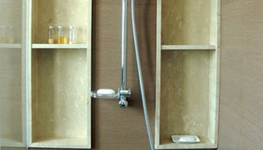 A shower with a hand held sprayer.