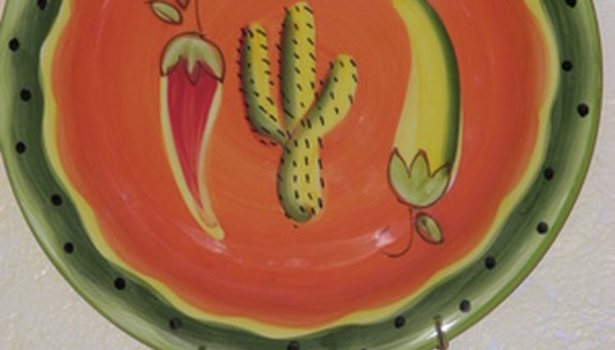 Drill a hole in a whimsical dinner plates to make a clock for the kitchen wall.