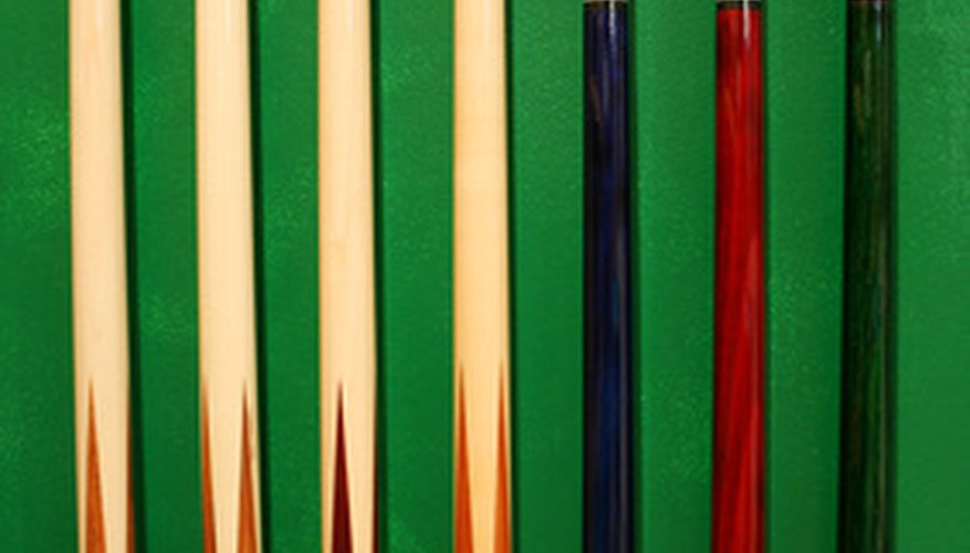 Bent pool cues can be straightened in some circumstances.