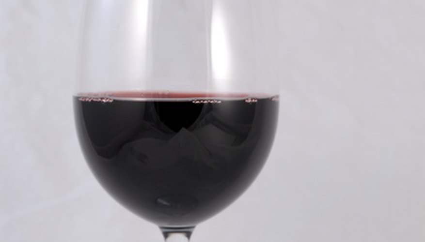 Red wine may leave a lingering odour if spilt on car carpet.