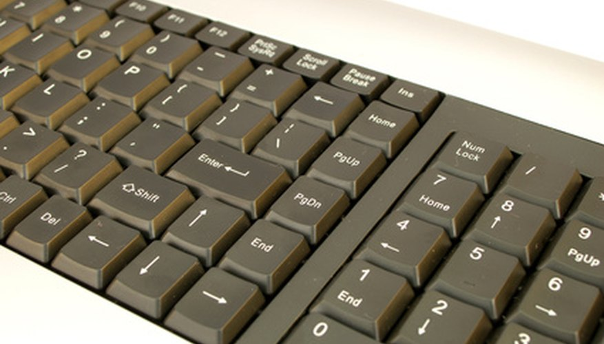 Use keys on the numeric keypad to type a division sign.