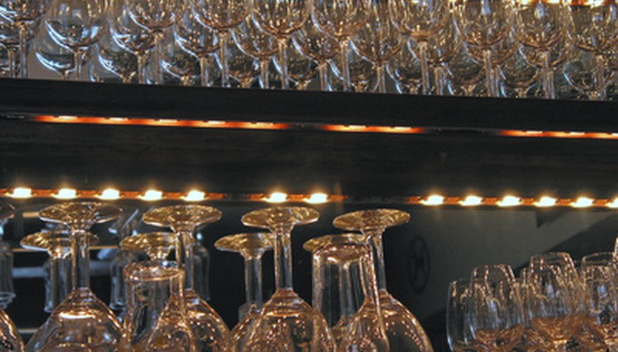 Glass collectors maintain the look of a bar.