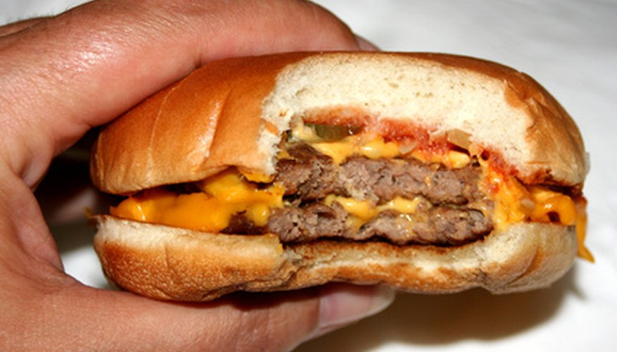 Cheesburgers violate kosher laws by mixing milk and meat.