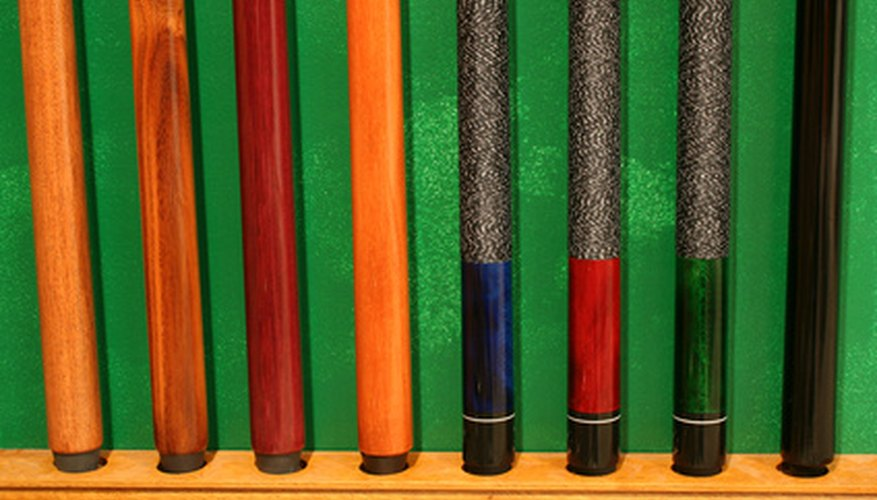 The one-piece snooker cue is shorter than two-piece pool sticks.