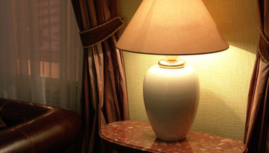 Parchment lamp shade on standard spider frame.