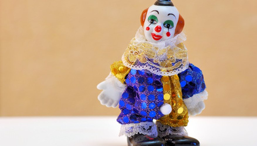 A clown costume can be inxpensively created using a sheet