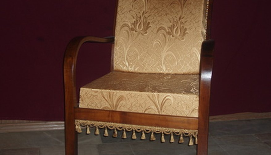 A webbing stretcher is a useful tool for reupholstering chairs.